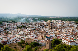 Aerial view from the castle 'Santa Anna' on the Spanish old town with the church 'San Roque', Oliva, Spain