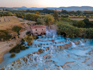 natural spa with waterfalls and hot springs at Saturnia thermal baths, Grosseto, Tuscany, Italy,Hot springs Cascate del Mulino with old watermill, Saturnia, Grosseto, Tuscany, Italy.