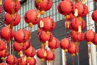 red Chinese lanterns hang up at street