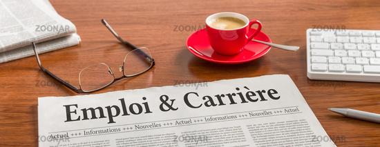 A newspaper on a wooden desk - Job and Career in french - Emploi et carrière