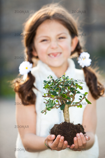 child caring for the environment