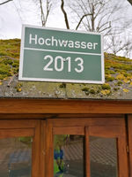 Marking the water level of the 2013 flood on the roof of a hut in the Herrenkrugpark in Magdeburg
