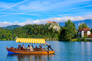 Tourists taking boat on Lake Bled, a popular tourist destination in Slovenia