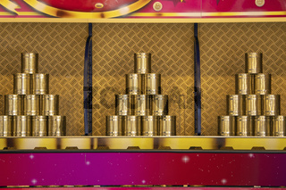 Game with tins in pyramid form