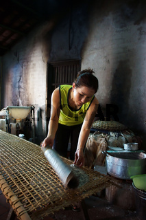 Woman make girdle cake (banh trang)