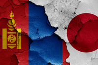 flags of Mongolia and Japan painted on cracked wall