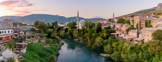 Old town of Mostar and Neretva River at sunset time in Bosnia and Herzegovina