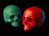 Abstract 2 sculpted red plastic and green wax skulls without lower jaws isolated on black background. 3d illustration