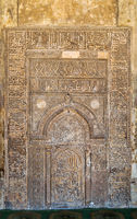 Ornate engraved stone wall with floral patterns and calligraphy, Ibn Tulun Mosque, Cairo, Egypt