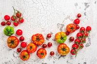 Assortment of organic tomatoes on old kitchen table