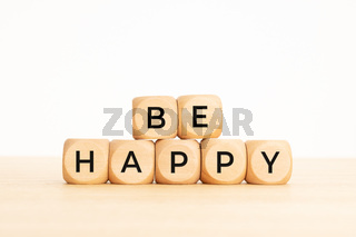Be Happy phrase on wooden blocks. Copy space