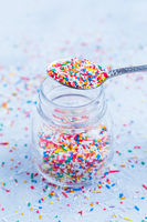Colorful sugar sprinkles for baking in icy tone - baking concept