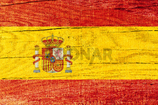 Spainish national flag printed on wooden cracked surface
