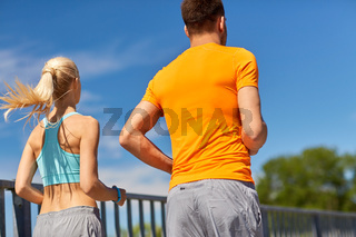 sporty couple running outdoors