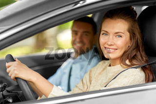car driving school instructor teaching woman