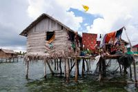 family in front of floating house