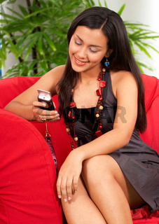 Young Woman Texting Her Friend
