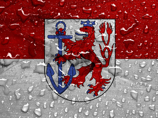 flag of Dusseldorf, Germany with rain drops