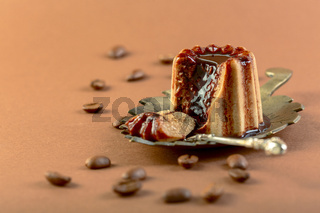 Coffee panna cotta with chocolate sauce.