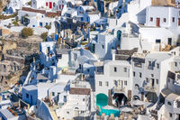 Colorful Buildings on the Rocky Caldera of Santorini