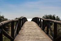 A long wooden boardwalk and beach access leads to beach and glistening ocean