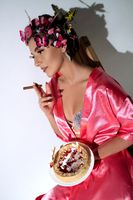 Young woman in lingerie with birthday cake