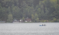 two fisher men in a boat on the lake Zel