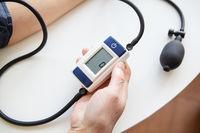 Measurement of blood pressure. The woman measures blood pressure. Self-diagnosis at home.