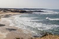 atlantic ocean with Praia do Carreiro da Fazenda near Vila Nova de Milfontes, Alentejo, Portugal