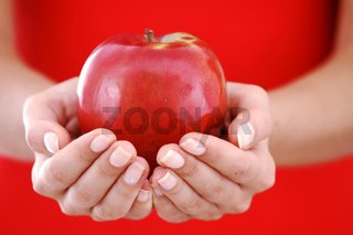 red apple in hand close up