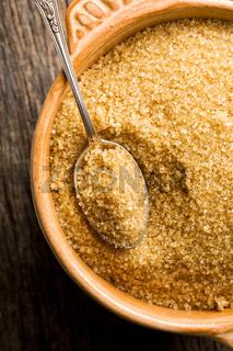 brown sugar in silver spoon