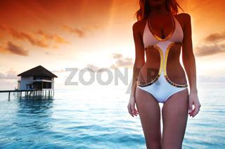 woman in a dress on maldivian sunset