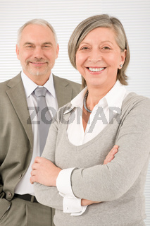 Senior businesspeople smile cross arms portrait
