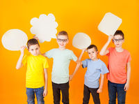 Thoughtful funny boys group with abstract idea clouds