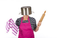 Funny elder woman with apron and pin roller