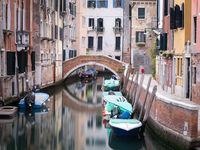 Traditional bridge over a small canal at Cannaregio, Venice - Italy