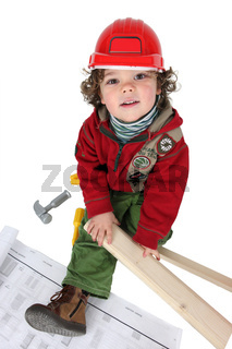 Little boy dressed as a builder