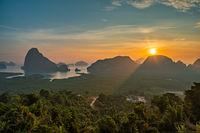 Tropical islands sunrise view at Samed Nang Chee viewpoint with bay to sea ocean, Phang Nga Thailand nature landscape