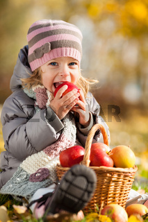 Kid eating red apple
