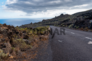 Empty road in a volcanic landscape in the Island of La Palma