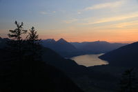 Sunset scene in the Swiss Alps. Outlines of Mount Niesen, Stockhorn and others.