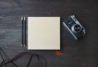 Book, pencils, camera