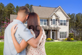 Military Couple Looking at Nice New House