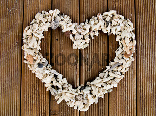 Heart shaped stones on old striped wood planks
