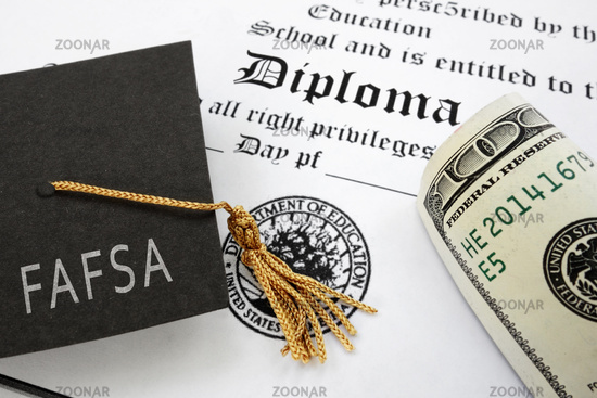FAFSA (Free Application for Federal Student Aid) text on graduation cap with diploma and money