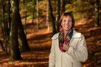 Smiling woman in the autumn forest