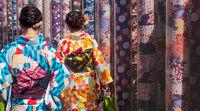 Woman in traditional dress visiting kimono forest at Arashiyama Station, Kyto, Japan