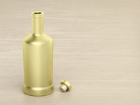 Gold bottle on wood table