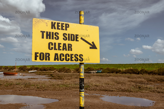 Sign: Keep This Side Clear For Access