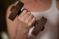 fist with iron dumbbell